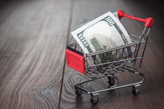 A hundred dollars in the shopping trolley Royalty Free Stock Photos