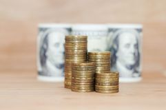 A hundred dollars with coins. A hundred dollars with stack of coins Royalty Free Stock Images
