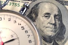 Hundred dollars and timer. Closeup Stock Image