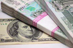 Hundred dollars and two packs to one thousand rouble banknotes Stock Images