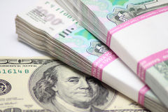 Hundred dollars and two packs to one thousand rouble banknotes Royalty Free Stock Photography