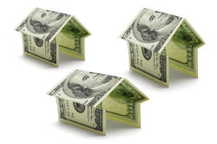 Hundred dollars US notes in shapes of houses Stock Photo