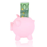 Hundred euro banknote and coinbank. Pink piggy bank with 100 euro banknote on a white background Stock Photography