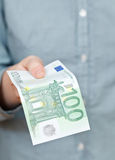Hundred euro banknote in hand Stock Images