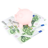 Hundred euro banknotes and coinbank. Piggy coinbank on a hundred euro banknotes Stock Image
