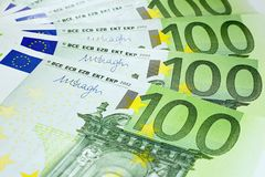Hundred euro banknotes ready for payment. Hundred euro bills stacked on each other ready for payment Stock Photo