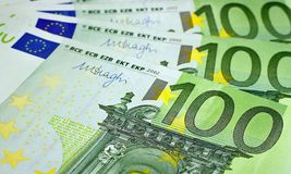 Hundred euro banknotes ready for payment. Hundred euro bills stacked on each other ready for payment Stock Image