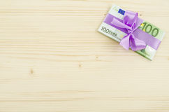 Hundred euro bill with pink bow Stock Photo