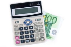 Hundred euro and calculator Stock Photography