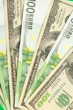 Hundred euro and dollar banknotes Stock Images