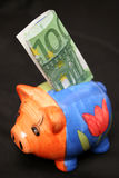 Hundred euro and piggy Royalty Free Stock Image