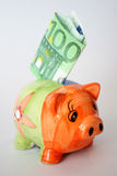 Hundred euro and piggy Stock Images