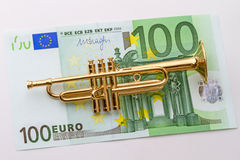 Hundred euro and trumpet Stock Photography