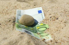 Hundred euro under the stone. Royalty Free Stock Photography