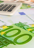 Hundred euros and calculator Royalty Free Stock Photo