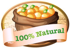 A hundred percent natural label with a sack of oranges Royalty Free Stock Image