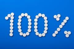 Hundred percent pills Royalty Free Stock Photos