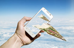 Hundred-ruble notes folded in the form of the aircraft flying fr Stock Images