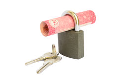 Hundred rupee Pakistani currency note rolled in a padlock Stock Photos