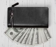 Hundred US Dollars Banknotes in Black Leather Wallet Stock Image