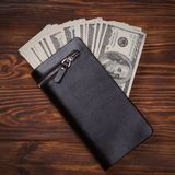 Hundred US Dollars Banknotes in Black Leather Wallet Royalty Free Stock Photos
