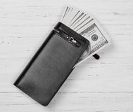 Hundred US Dollars Banknotes in Black Leather Wallet Royalty Free Stock Image
