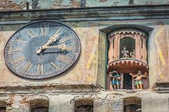 An hundred-year-old clock with animated cartoons. Somewhere in the old citadel of Sighisoara in Transylvania near Dracula`s house royalty free stock photos