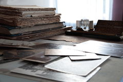 Hundred years old books and photos. Royalty Free Stock Images