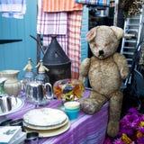 Hundred years old and sad teddy bear. On flea market Stock Image