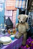 Hundred years old and sad teddy bear. On flea market Stock Photo