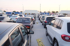 Hundreds of cars gathered in turn on a ferry Royalty Free Stock Photo
