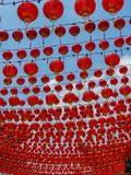 Hundreds of Chinese Temple Red Lanterns against a blue sky stock photos