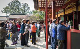 Hundreds of Chinese tourists are enter the Dazaifu shrine. Royalty Free Stock Images