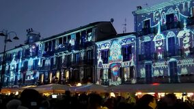 Splendid Italian square with hundreds of Christmas images directly projected on the facades of ancient buildings