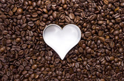Hundreds of coffee beans with a heart cutter Stock Photography