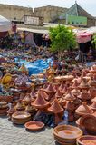Hundreds of colorful tajine cooking pots stacked on market in soukh of Meknes, Morocco, North Africa royalty free stock image