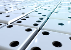 Hundreds of dice fading into the distance. Hundreds of dice arranged in a grid stretching into the distance stock image