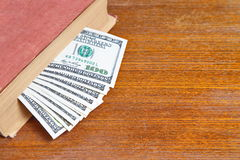 Hundreds dollar bills in book Royalty Free Stock Images