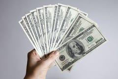 Hundreds of Dollars. A hand full of hundred dollar pills Royalty Free Stock Photography
