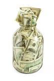 Hundreds of dollars stuffed in. Glass jar full of  hundreds of dollars isolated on white background Stock Photo