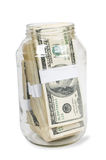 Hundreds of dollars stuffed in a glass jar Stock Images