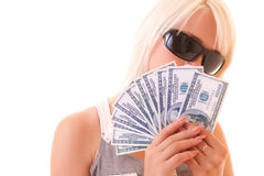 Hundreds of dollars on young woman background Royalty Free Stock Photography
