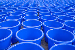 Hundreds of empty blue water bucket laid on the floor Stock Images