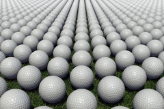 Hundreds of golf balls lined up on a meadow. Render with several hundreds of golf balls lined up on a meadow. The medium depth of field, a randomized rotation Royalty Free Stock Image