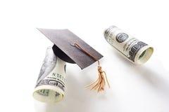 Hundreds and grad cap. Mini graduation cap and hundred dollar bills Stock Photography