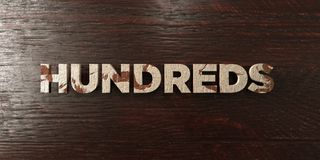 Hundreds - grungy wooden headline on Maple  - 3D rendered royalty free stock image. This image can be used for an online website banner ad or a print postcard Royalty Free Stock Photography