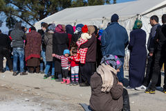 Hundreds of immigrants are in a wait at the border between Greec. Idomeni, Greece, February 7, 2016: Hundreds of immigrants are in a wait at the border between Royalty Free Stock Photography