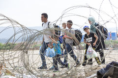 Hundreds of immigrants are in a wait at the border between Greec. Idomeni, Greece - September 24 , 2015: Hundreds of immigrants are in a wait at the border royalty free stock photography