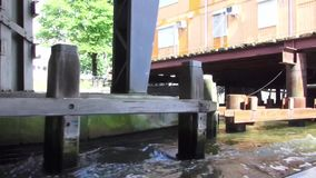 Through the canals of Amsterdam. Hundreds of kilometers of canals, more than 1,500 bridges and about 90 islands allowed Amsterdam to receive the title of ` stock video footage