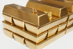 Deposit of illegal gold in amount of 500 kilos in standard bricks. Hundreds kilos of illegal gold bullions on background royalty free stock photo